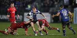 Bath's Tom Homer is tackled by Saracens Nick Isiekwe and Tom Woolstencroft during the Gallagher Premiership match at the Recreation Ground, Bath.