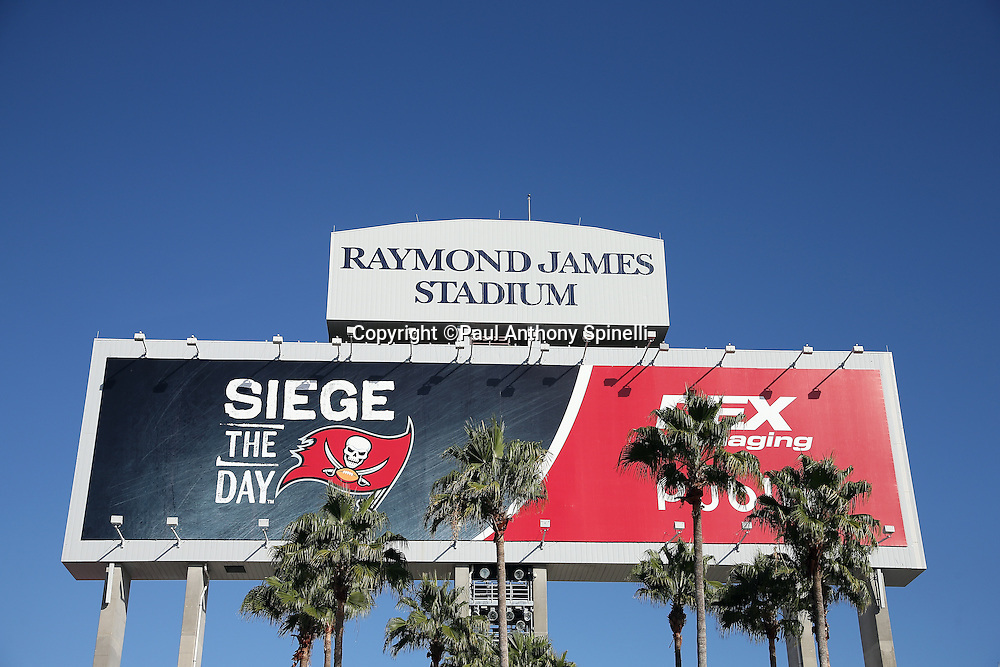 The Raymond James Stadium sign rests on top of a stadium billboard before the Tampa Bay Buccaneers 2015 week 14 regular season NFL football game against the New Orleans Saints on Sunday, Dec. 13, 2015 in Tampa, Fla. The Saints won the game 24-17. (©Paul Anthony Spinelli)