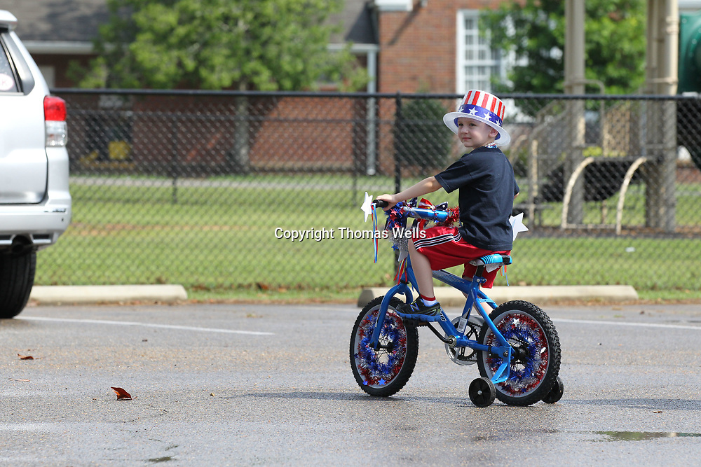 Jace McRae, 3, has bike and himself decked out for Tuesday's parade through Joyner on Tuesday.