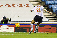Darren Pratley of Bolton Wanderers scores the opening goal against Millwall during the Sky Bet Championship match at The Den, London<br /> Picture by David Horn/Focus Images Ltd +44 7545 970036<br /> 19/12/2014