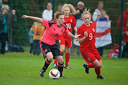 NEWPORT, WALES - Sunday, April 3, 2016: Scotland's Michaela McAlonie in action against England's Libby Smith during Day 3 of the Bob Docherty International Tournament 2016 at Dragon Park. (Pic by David Rawcliffe/Propaganda)