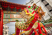 14 OCTOBER 2012 - BANGKOK, THAILAND:  Teams of dancers perform as they enter a shrine on Yaowarat Road on the first day of the Vegetarian Festival in Bangkok's Chinatown. The Vegetarian Festival is celebrated throughout Thailand. It is the Thai version of the The Nine Emperor Gods Festival, a nine-day Taoist celebration beginning on the eve of 9th lunar month of the Chinese calendar. During a period of nine days, those who are participating in the festival dress all in white and abstain from eating meat, poultry, seafood, and dairy products. Vendors and proprietors of restaurants indicate that vegetarian food is for sale by putting a yellow flag out with Thai characters for meatless written on it in red.     PHOTO BY JACK KURTZ