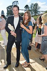 BLAISE PATRICK and LEONORA GAST at the Summer Solstice Party during the Boodles Tennis event hosted by Beulah London and Taylor Morris at Stoke Park, Park Road, Stoke Poges, Buckinghamshire on 21st June 2014.