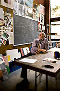 Portrait of an art teacher in his studio classroom at The Asheville School in Asheville, North Carolina