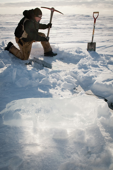 An Iñupiat from Point Hope, Alaska, chops river ice for drinking water.