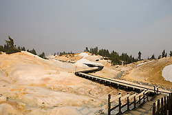 A boardwalk allows park visitors to safely view Bumpass Hell, the largest hydrothermal area in Lassen Volcanic National Park, California, USA.