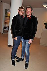 Left to right, GARY COCKERILL and PHIL TURNER at the Lighthouse Gala Auction in aid of The Terrence Higgins Trust held at Christie's, 8 King Street, St.James' London on 19th March 2012.
