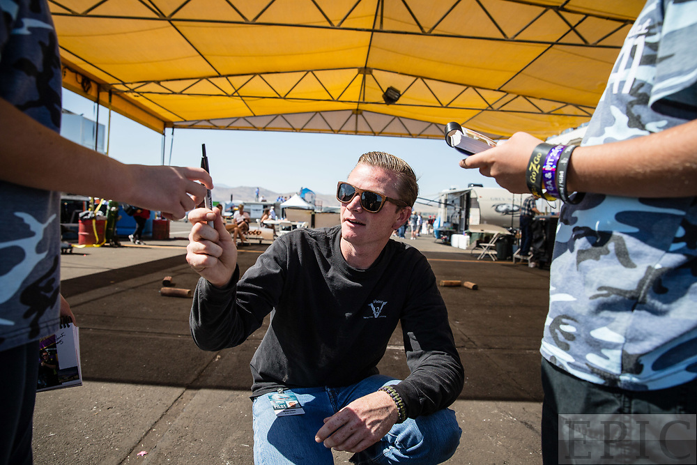 RENO, NV - SEPTEMBER 17: World record holder Steve Hinton signs autographs for fans at the Reno Championship Air Races on September 17, 2017 in Reno, Nevada. (Photo by Jonathan Devich/Getty Images) *** Local Caption *** Steve Hinton