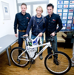 CULT and Tomaz Vnuk with a bike  as a present at the press conference due to the end of the career of Slovenian ice-hockey player Tomaz Vnuk,  on October 05, 2009, in Hala Tivoli, Ljubljana, Slovenia.   (Photo by Vid Ponikvar / Sportida)