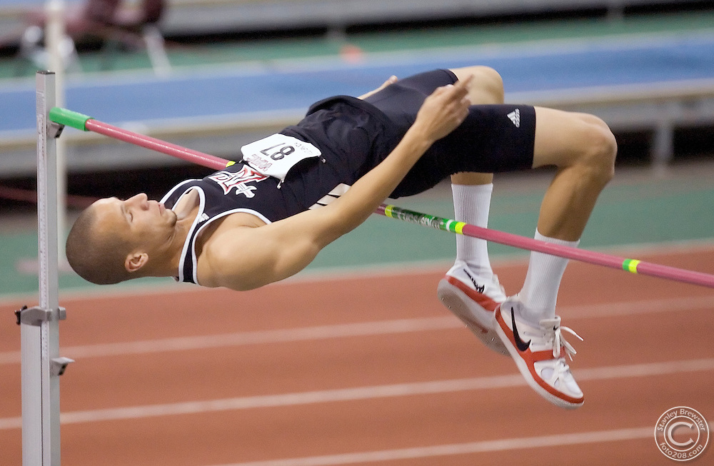 """2-24-06.Nampa, ID. Alex Marbley of Cal State Northridge wins the WAX individual title in the High Jump with a jump of 6' 10.25""""."""