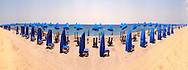 180˚ Panorama of Beach with Beach Umbrellas and Wind Shelter Seats