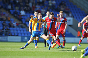 Ollie Rathbone is challenged during the EFL Sky Bet League 1 match between Shrewsbury Town and Rochdale at Greenhous Meadow, Shrewsbury, England on 8 April 2017. Photo by Daniel Youngs.