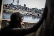 A view of Kamrangirchar from the bus in Dhaka. Kamrangirchar is a slum of Dhaka, full of many small factories.