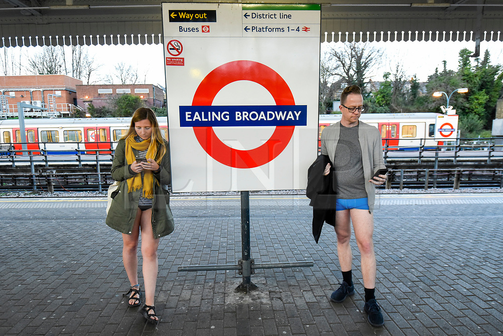 """© Licensed to London News Pictures. 12/01/2020. LONDON, UK.  Participants take part in """"No Trousers On The Tube Day"""".  Now in its 11th year, the annual event sees hundreds of riders travel on the tube without wearing trousers.  Similar rides are taking place worldwide under the umbrella of """"No Pants Subway Ride"""", which launched in New York in 2002.  Photo credit: Stephen Chung/LNP"""