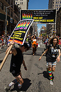 New York, NY - 25 June 2017. New York City Heritage of Pride March filled Fifth Avenue for hours with groups from the LGBT community and it's supporters. Marchers from Refuse Fascism.