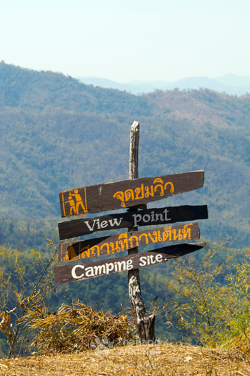 Sign post at Pu Toei National Park in Suphanburi, Thailand, February 2007.