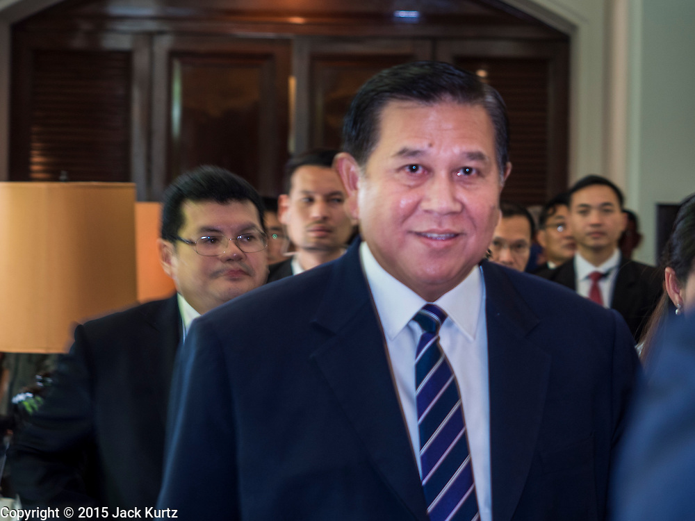 "29 MAY 2015 - BANGKOK, THAILAND: H.E. General TANASAK PATIMAPRAGORN, Deputy Prime Minister and Minister of Foreign Affairs of Thailand,  walks into a press conference at the ""Special Meeting on Irregular Migration in the Indian Ocean."" Thailand organized and hosted the meeting at the Anantara Siam Hotel in Bangkok. The meeting brought together representatives from the 5 countries impacted by the boat people exodus: Thailand, Malaysia and Indonesia, which have all received boat people, and Myanmar (Burma) and Bangladesh, where they are coming from. Non-governmental organizations, like the International Organization for Migration (IOM) and UN High Commissioner for Refugees (UNHCR) as well as countries responding to the crisis, like the United States, also attended the meeting. A total of 22 organizations attended the one day conference.      PHOTO BY JACK KURTZ"
