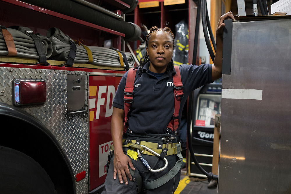 Firefighter Melissa Bennett poses for a photograph at the quarters of Engine 257, 1361 Rockaway Parkway, Brooklyn, NY on Tuesday, Oct. 6, 2015.<br /> <br /> Andrew Hinderaker for The Wall Street Journal<br /> NYFDNY