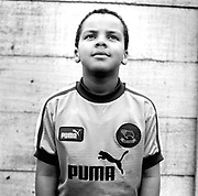 Six year old boy football fan Puma UK 1990's