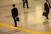 businessmen walking in the corridor of large office building
