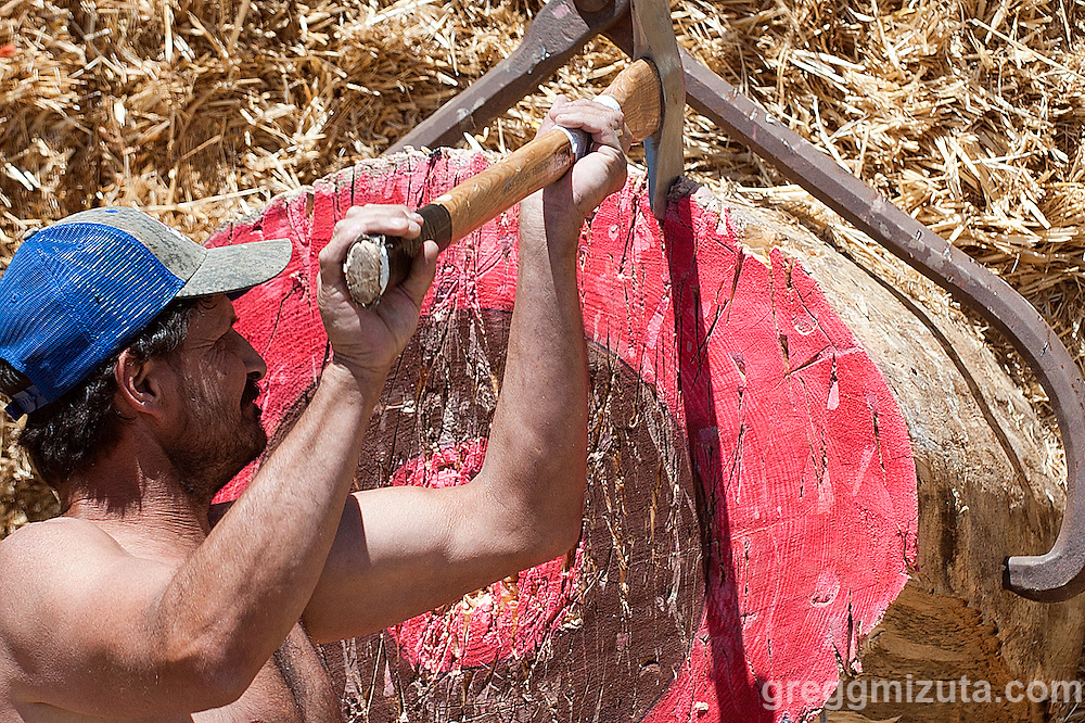 Loren Schuman practicing for the Payette River Games lumberjack competition at Kelly's Whitewater Park in Cascade, Idaho on June 21, 2014.