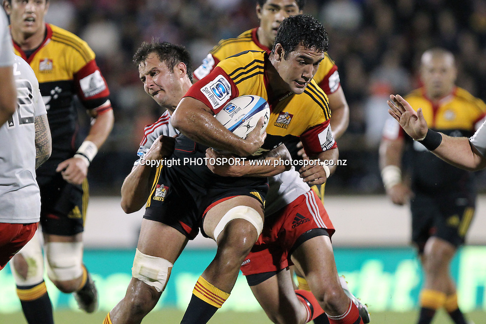 Chiefs' Romana Graham is tackled by Crusaders' Matt Berquist. Super 15 rugby union match, Chiefs v Crusaders at Baypark Stadium, Mt Maunganui, New Zealand. Friday 15th April 2011. Photo: Anthony Au-Yeung / photosport.co.nz