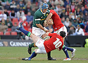 Juan Smith of the Springboks hands off Stephen Jones of the Lions with Mike Phillips of the Lions making the tackle.<br /> Rugby - 090704 - Springboks vs British&Irish Lions - Coca-Cola Park - Johannesburg - South Africa. The Lions won 28-9 but lost the series 2-1 to the Springboks.<br /> Photographer : Anton de Villiers / SASPA