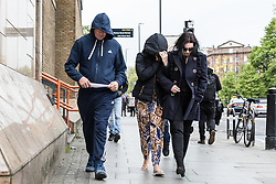 © Licensed to London News Pictures. 24/04/2017. LONDON, UK. The family of Arthur Collins, including his father (left, blue hoody) and mother (wearing black sunglasses) leave Thames Magistrates Court in London. Arthur Collins, 24, the boyfriend of reality TV star, Ferne McCann and Andre Phoenix, 21 appeared at Thames Magistrates Court today, charged with offences in connection with an acid attack at Mangle nightclub in Dalston, Hackney on 17th April which left a man and a woman each blind in one eye. Both were remanded in custody. Photo credit: Vickie Flores/LNP