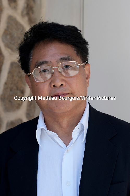 Qiu Xiaolong, born in Shanghai, China in 1953, is an English language poet, literary translator, crime novelist, critic, and academic, currently living in St. Louis, Missouri.  Photographed at the Etonnants Voyageurs (Astonishing Travellers) literary festival in Saint Malo, France. Taken 19th May 2012<br /> <br /> Picture by Mathieu Bourgois/Writer Pictures<br /> <br /> NO FRANCE