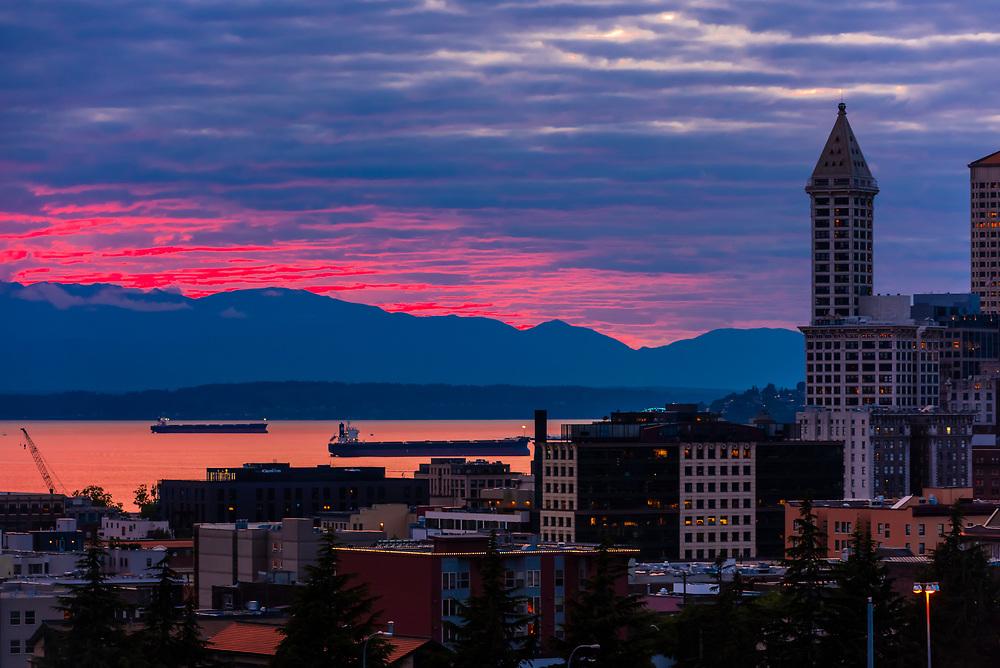 Oil tankers passing through Puget Sound at twilight, Seattle, Washington USA.