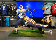 Oct 19, 2018; London, United Kingdom; General overall view of mannequins with the helmet and uniform of Tennessee Titans cornerback Adoree Jackson (25) and Los Angeles Chargers running back Melvin Gordon (28) with Chargers cornerback Casey Hayward (26) on the video display at Niketown London.