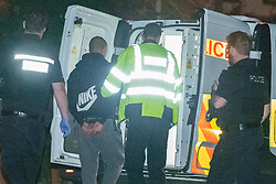 © Licensed to London News Pictures. 23/07/2020. Thame, UK. A male is arrested at the scene in Thame and walked to a waiting police van. Thames Valley Police has launched a murder investigation in Thame. At approximately 19:05BST a man was found with injuries in Chinnor Road, Thame. The 20-year-old man was pronounced dead at the scene. Photo credit: Peter Manning/LNP