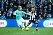 Derby County forward Johnny Russell (#7) defends the ball from Newcastle United defender DeAndre Yedlin (#22) during the EFL Sky Bet Championship match between Newcastle United and Derby County at St. James's Park, Newcastle, England on 4 February 2017. Photo by Craig Doyle.