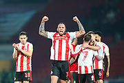 Sunderland defender Joel Lynch (3) gestures to the Sunderland fans following the EFL Sky Bet League 1 match between Doncaster Rovers and Sunderland at the Keepmoat Stadium, Doncaster, England on 29 December 2019.