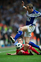 LIVERPOOL, ENGLAND - Saturday, April 23, 2011: Liverpool's John Flanagan in action against Birmingham City's Lee Bowyer during the Premiership match at Anfield. (Photo by David Rawcliffe/Propaganda)