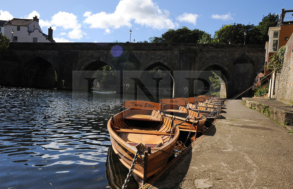 © Licensed to London News Pictures. <br /> 24/09/2014. <br /> <br /> Durham, United Kingdom<br /> <br /> Rowing boats lined up ready for hire on the River Wear in Durham City.<br /> <br /> <br /> Photo credit : Ian Forsyth/LNP