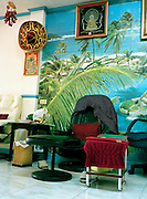 A mural of palm trees at a foot massage parlor.
