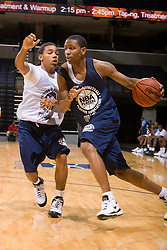 G/F Rodney McGruder (Washington, DC / Archbishop Carroll) dribbles past PG Phillip Pressey (Ashburnham, MA / Cushing Academy).  The NBA Player's Association held their annual Top 100 basketball camp at the John Paul Jones Arena on the Grounds of the University of Virginia in Charlottesville, VA on June 20, 2008