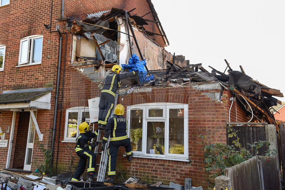 © Licensed to London News Pictures. 22/10/2018. LONDON, UK.  Firefighters at the site of a fire in a first-floor flat, caused by a suspected gas explosion, in Fulbeck Way, Harrow, north west London, which took place in the early hours of 21 October  It has been reported that a woman died at the scene, and another woman, a man and a baby were rescued from the property. Investigations continue as to the cause of the fire. Photo credit: Stephen Chung/LNP