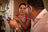 Yuliana observa a su padre, Miguel Angel Viloria (d) mientras le muestra su tarea escolar. Gracias a FundaHigado, Yuliana recibió un trasplante de higado que le permite disfrutar de la vida. Punto Fijo, Venezuela 26 y 27 Oct. 2012. (Foto/ivan gonzalez)