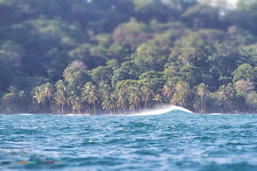 Surf breaks over the shoals along side Isla Bastimentos.