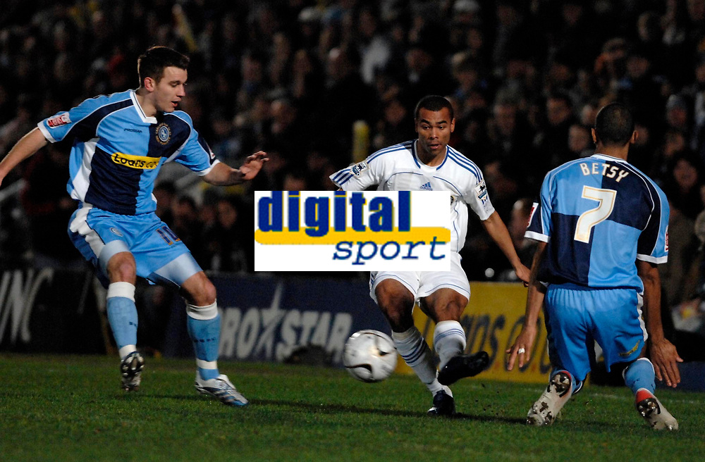 Photo: Richard Lane.<br />Wycombe Wanderers v Chelsea. Carling Cup, Semi Final 1st Leg. 10/01/2007. <br />Chelsea's Ashley Cole breaks past Russel Martin and Kevin Betsy.