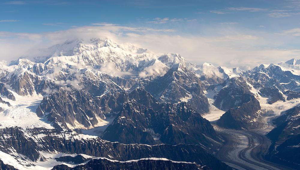 Aerial view of Denali (Mt. McKinley), the Tokositna Glacier (right), the Kahiltna Glacier (left) and the Alaska Range on a sightseeing flight from Talkeetna, Alaska.