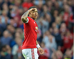MANCHESTER, ENGLAND - Tuesday, August 18, 2015: Manchester United's Memphis Depay celebrates scoring the first goal against Club Brugge during the UEFA Champions League Play-Off Round 1st Leg match at Old Trafford. (Pic by David Rawcliffe/Propaganda)