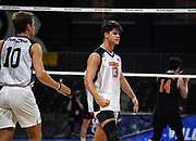 Pepperdine Waves middle blocker Max Chamberlain (13) and Kaleb Denmark (10) celebrate against the Princeton Tigers during an NCAA Championships opening round match, Wednesday, April 30, 2019, in Long Beach, Calif. Pepperdine defeated Princeton 25-23, 19-25, 25-16, 22-25, 15-8.