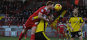 Matt Harrold climbing tall to win the header during the Sky Bet League 1 match between Crawley Town and Colchester United at Broadfield Stadium, Crawley, England on 28 December 2014. Photo by Michael Hulf.