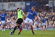 Portsmouth Defender, Matt Clarke (5) tackles Peterborough United Midfielder, Danny Lloyd (10) during the EFL Sky Bet League 1 match between Portsmouth and Peterborough United at Fratton Park, Portsmouth, England on 5 May 2018. Picture by Adam Rivers.