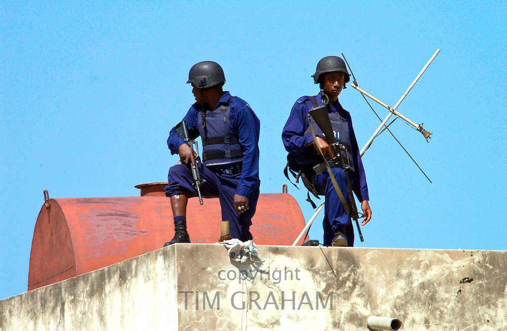 Security guards armed with guns and wearing bullet-proof vests for VIP visit at the Hugh Sherlock Centre which is part of the Jamaican Urban Poverty Project.