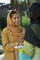 Two young muslim women talking outdoors