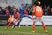 Lyle Taylor of AFC Wimbledon beats of luton town defence during the Sky Bet League 2 match between AFC Wimbledon and Luton Town at the Cherry Red Records Stadium, Kingston, England on 13 February 2016. Photo by Stuart Butcher.